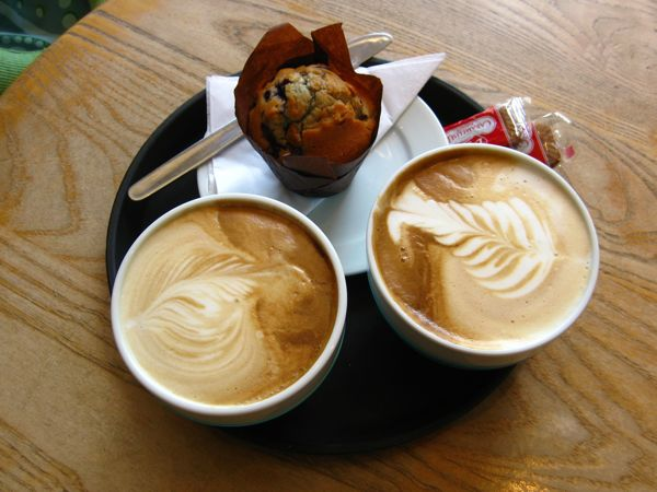 Two Lattes And A Blueberry Cheescake Muffin