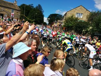 The peleton powering through Addingham!