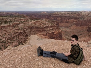 A teenager not even looking at the view!